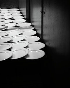 rows-of-empty-plates-ron-koeberer